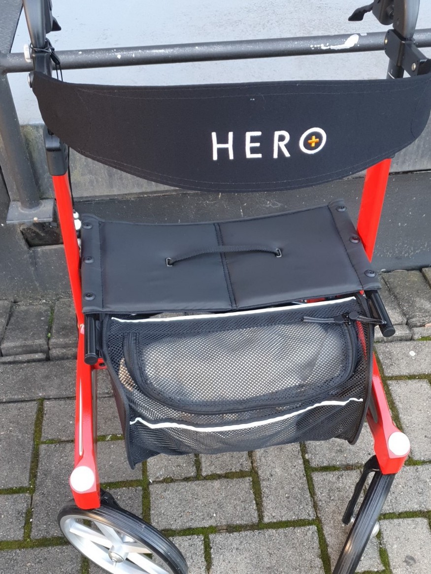 Black and red hero rollator with front basket FULL of everything I needed for my outing to the specialist