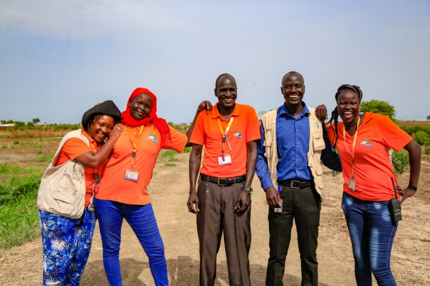 NP Staff smiling standing in South Sudan