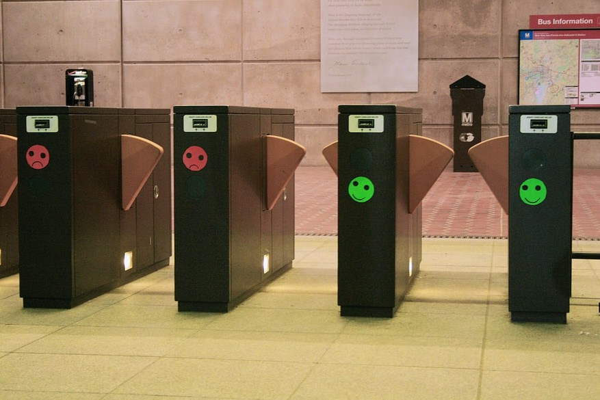Ticket booths with smiley faces in subway