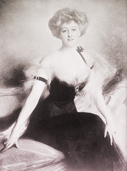 Mathilde wearing a black evening dress. Her blonde hair is in a fluffy updo.