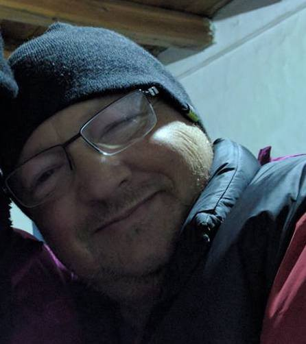 Color photo of Alex Tabony, a white man, looking relaxed and happy