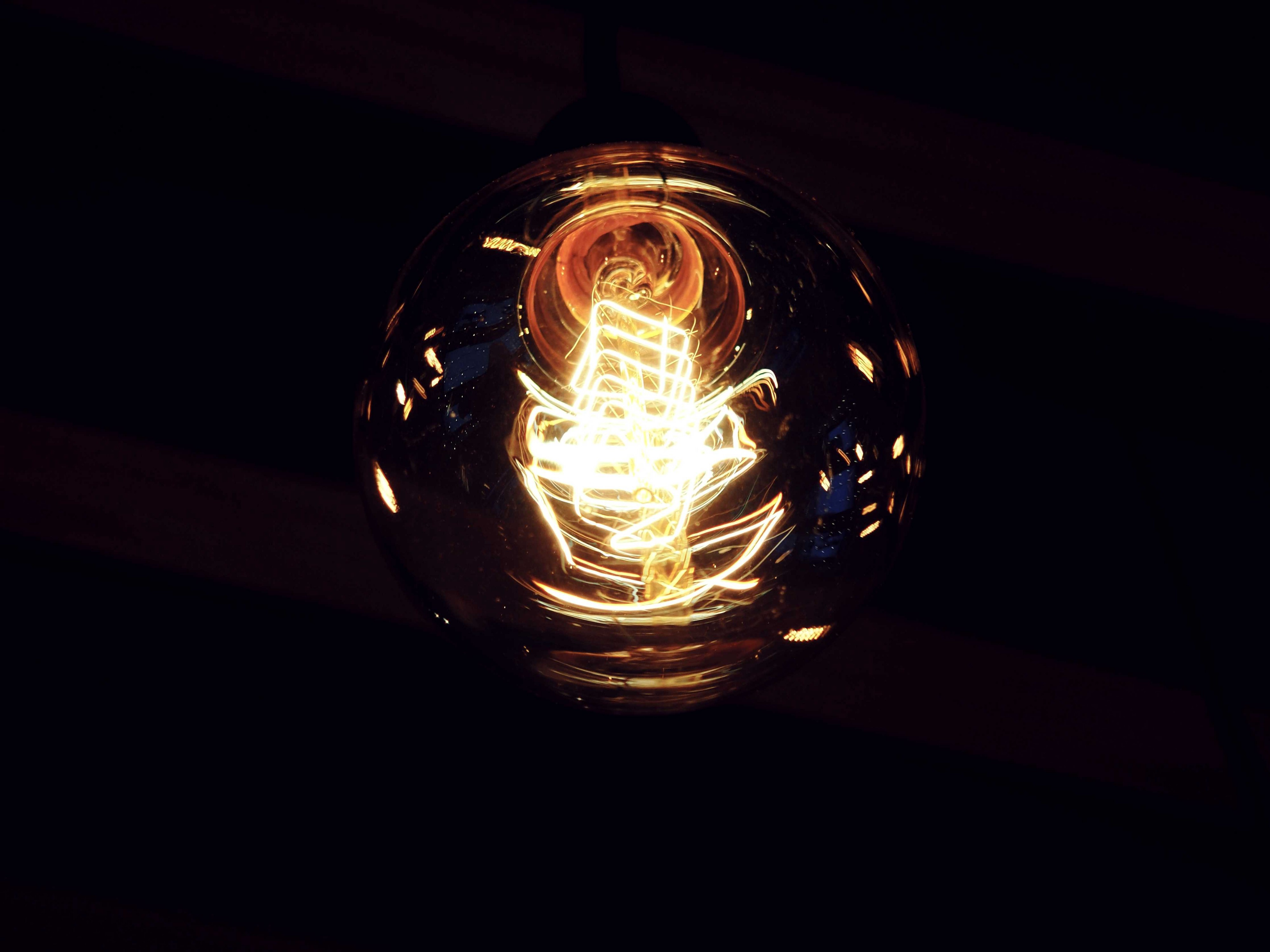 A light bulb filled with dancing energy.