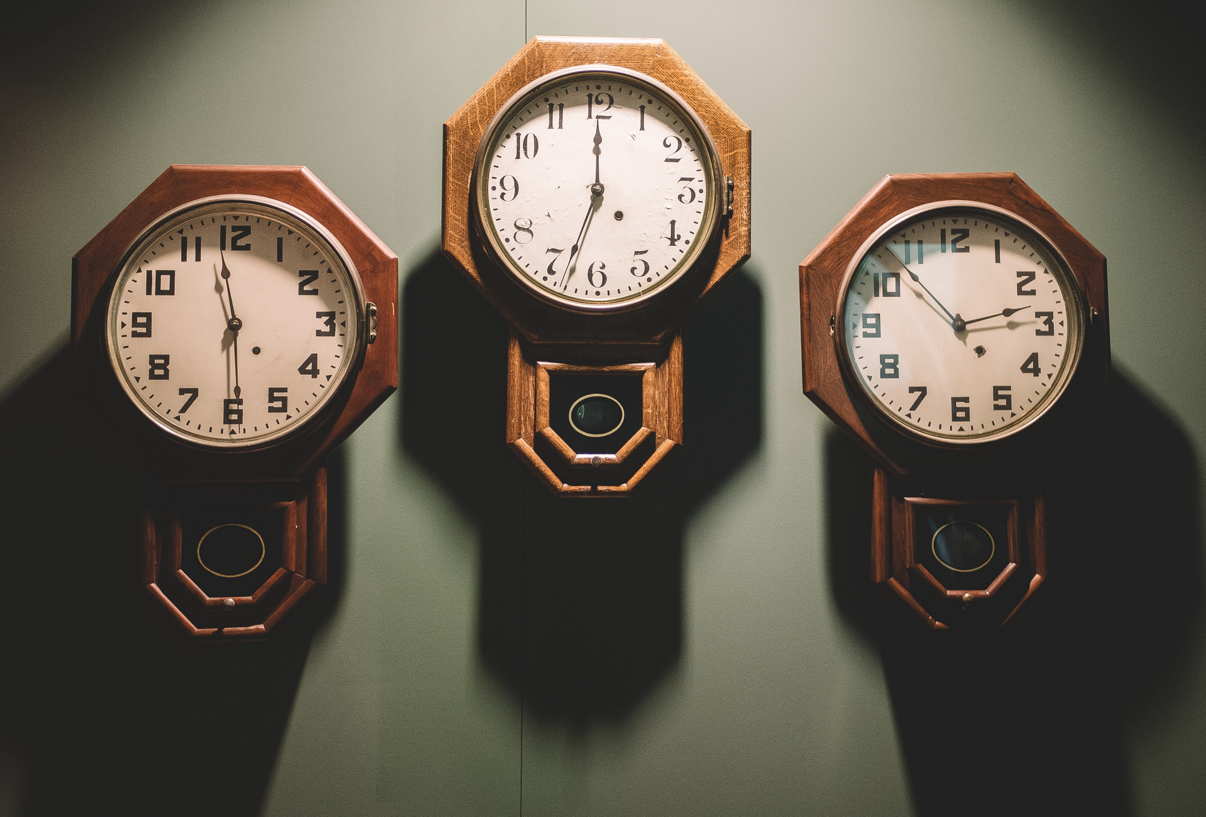Three clocks showing different times.