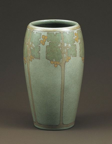 Tall, light green vase decorated with graphic, slender fruit trees.