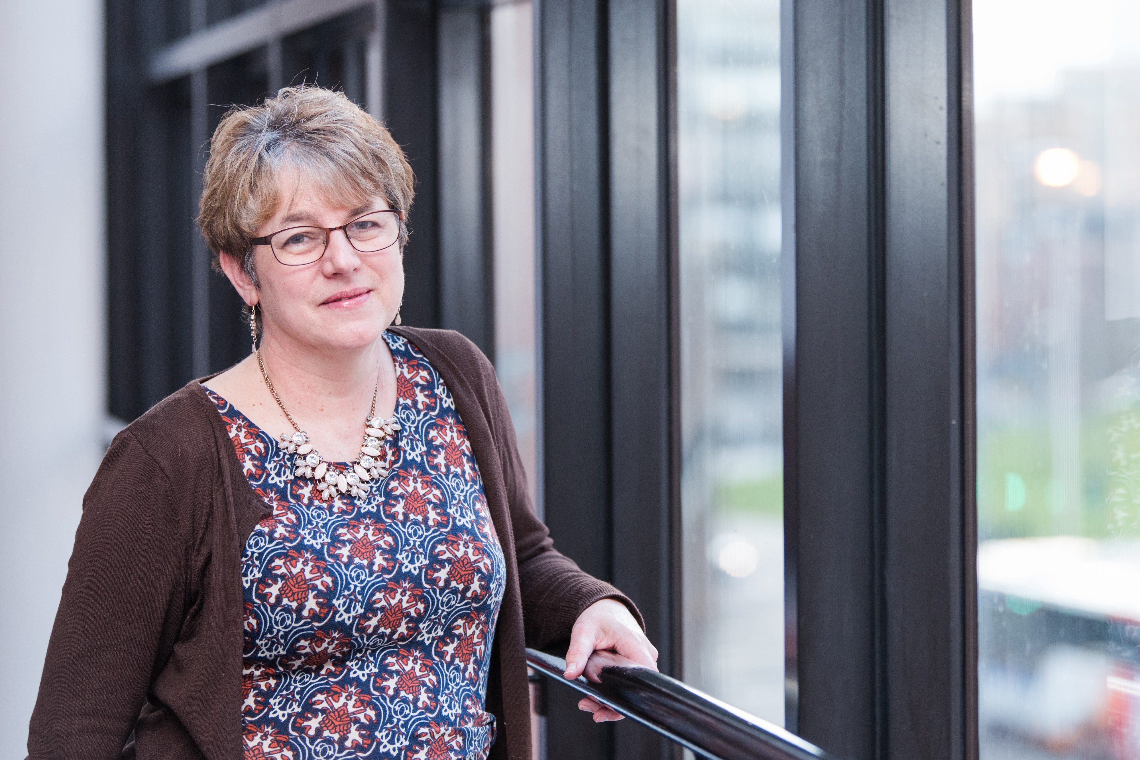 Image of the author standing by a window