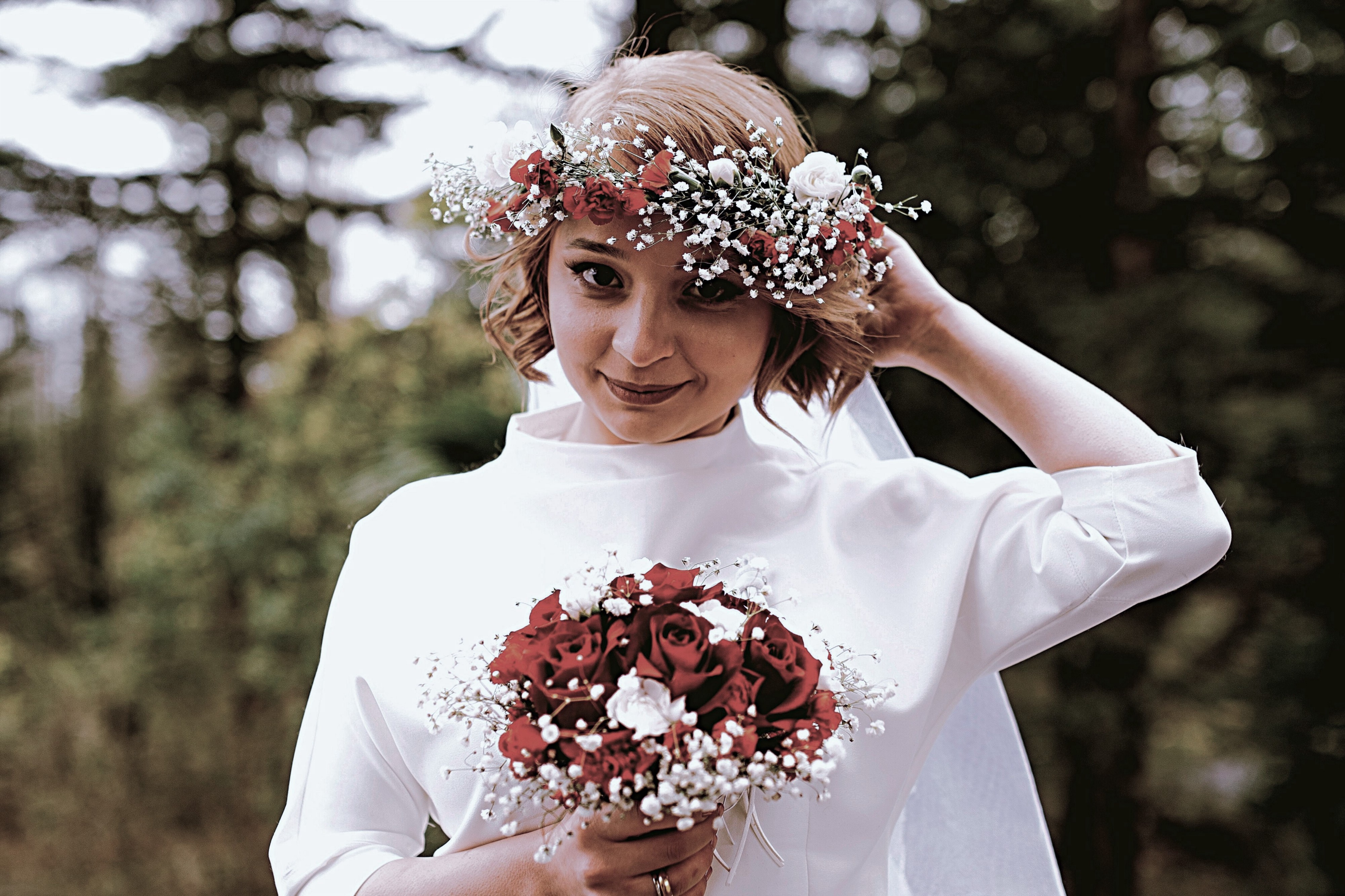 A bride wearing a modern gown and a floral headband
