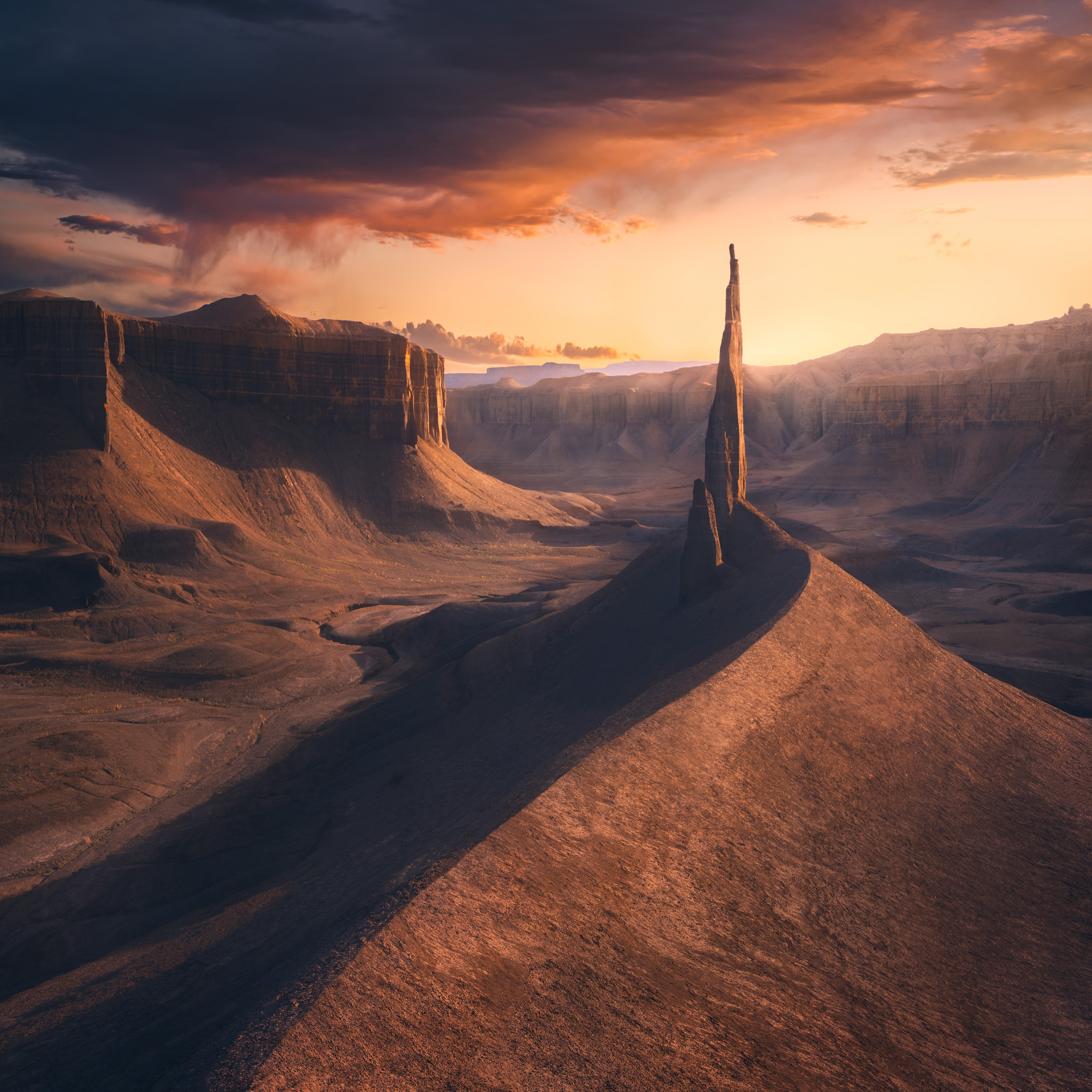 A photograph of a desert landscape, including one tall pointy natural structure