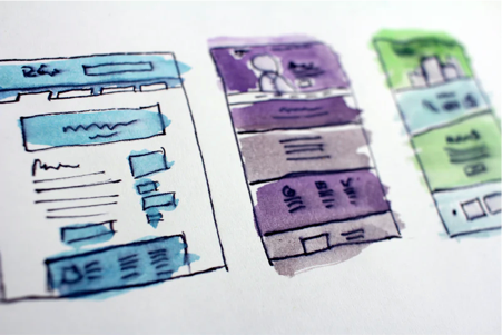 Image: Sketched wireframes for a website.