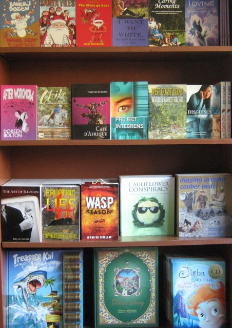 Photograph of a bookshelf dislaying colourful book covers