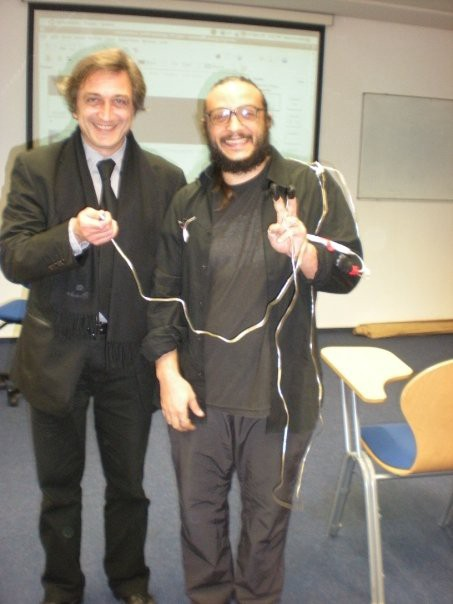 in 2009, at the Consciousness Reframed conference, Salvatore with Pier Luigi Capucci and the conference biofeedback device.