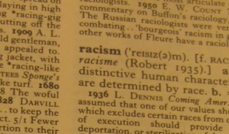 """A photo of the word """"racism"""" in a dictionary"""