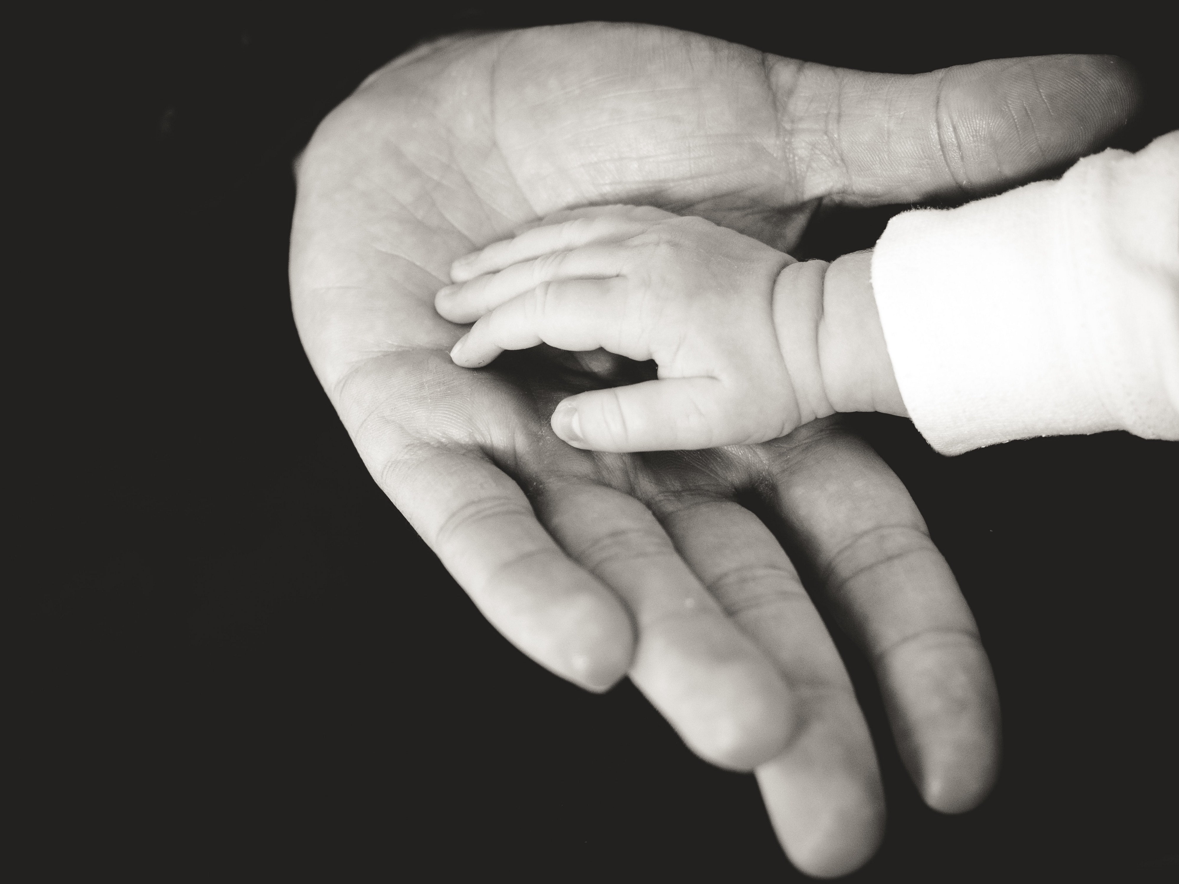 Father and child holding hands.