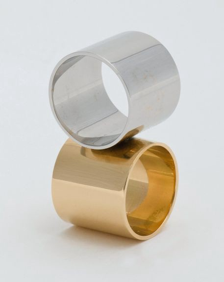Sculptural ring featuring a silver band atop a gold band.