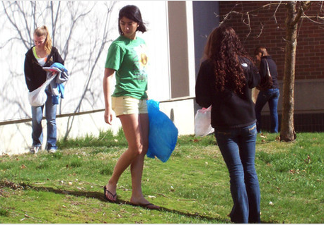 Image of students cleaning up trash