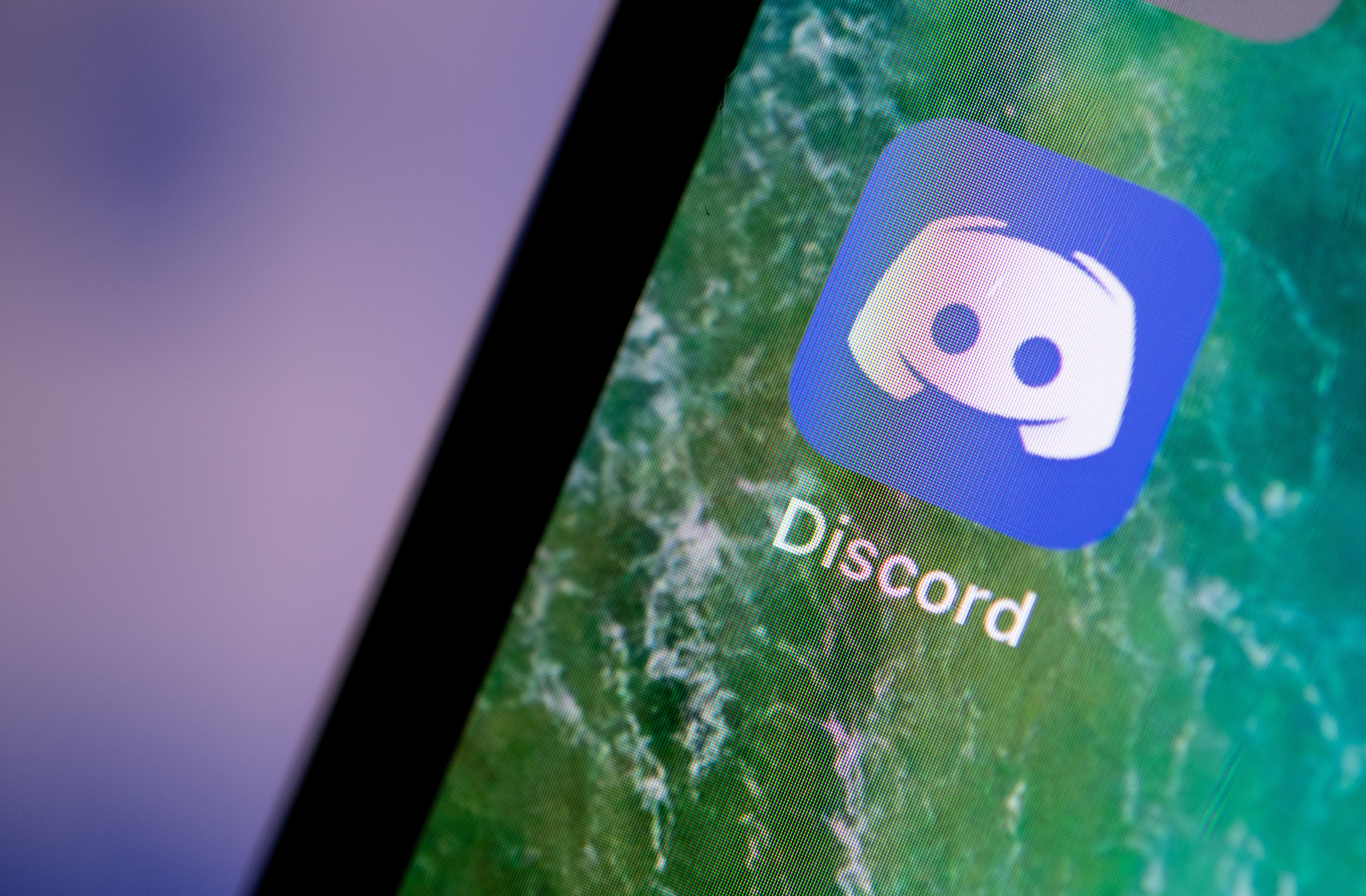 The Discord app displayed on the screen of an iPhone.