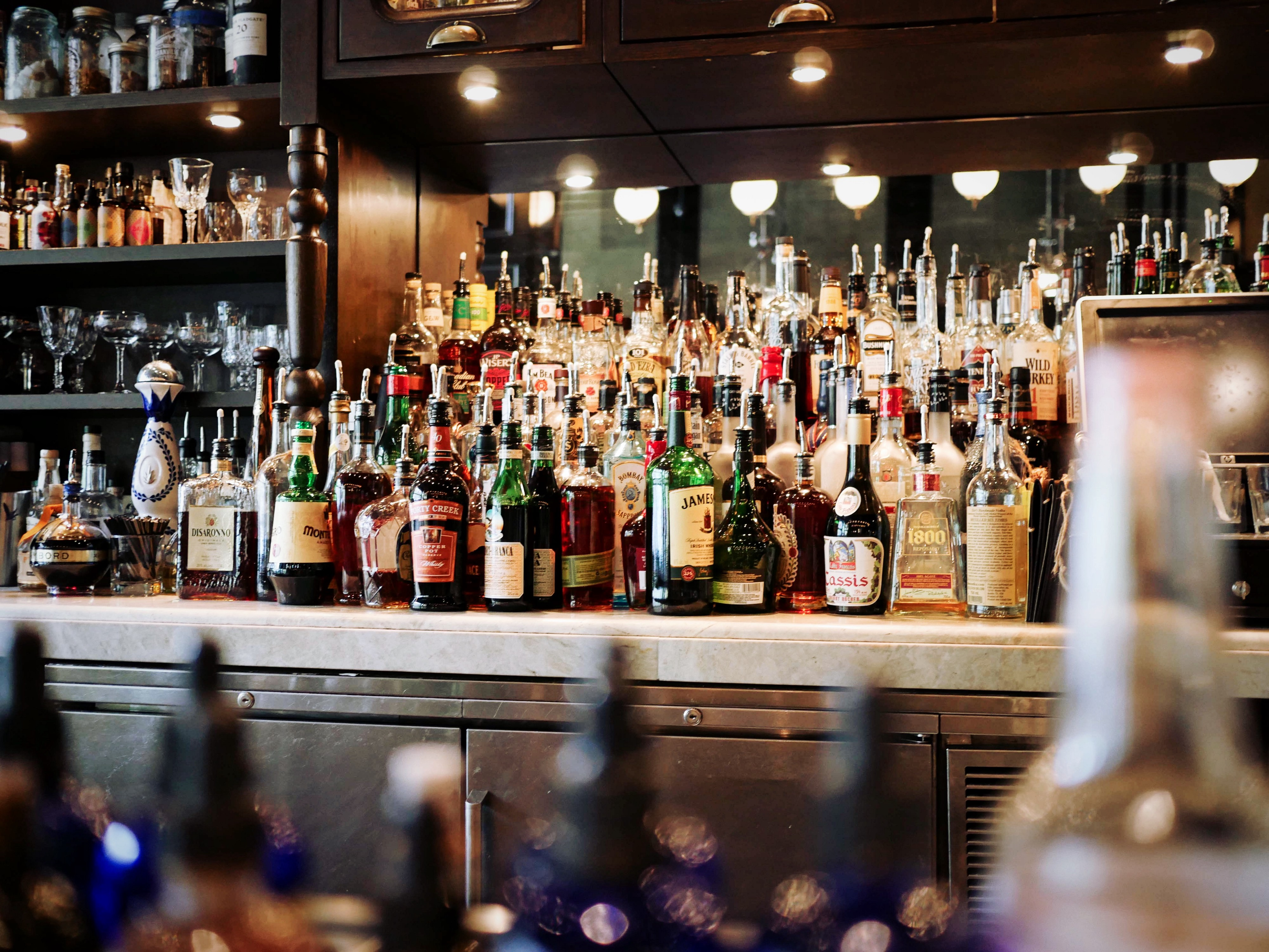 A shot of a bar, with bottles of spirits  on multiple levels