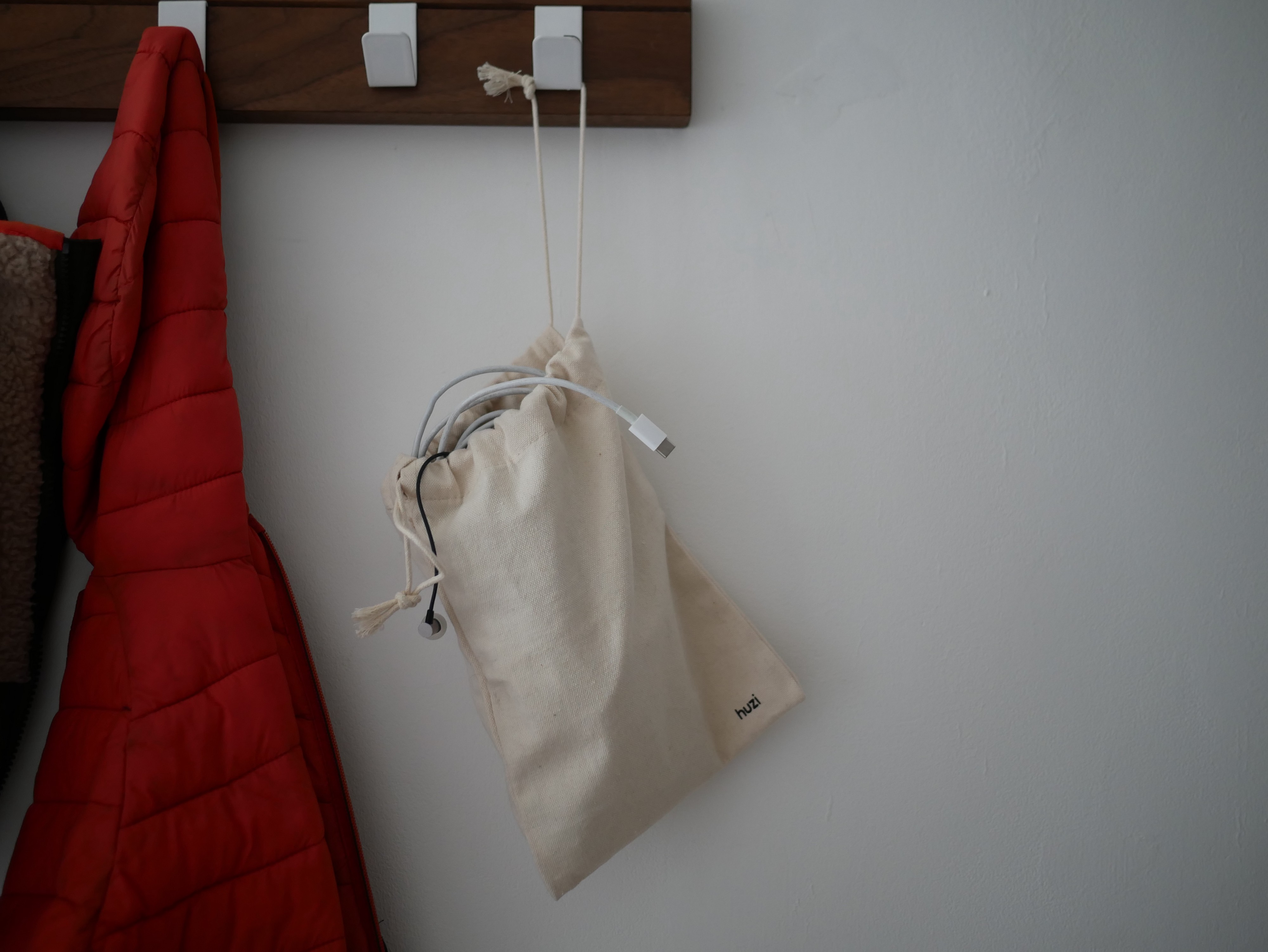A bag of cables hanging on a coat rack