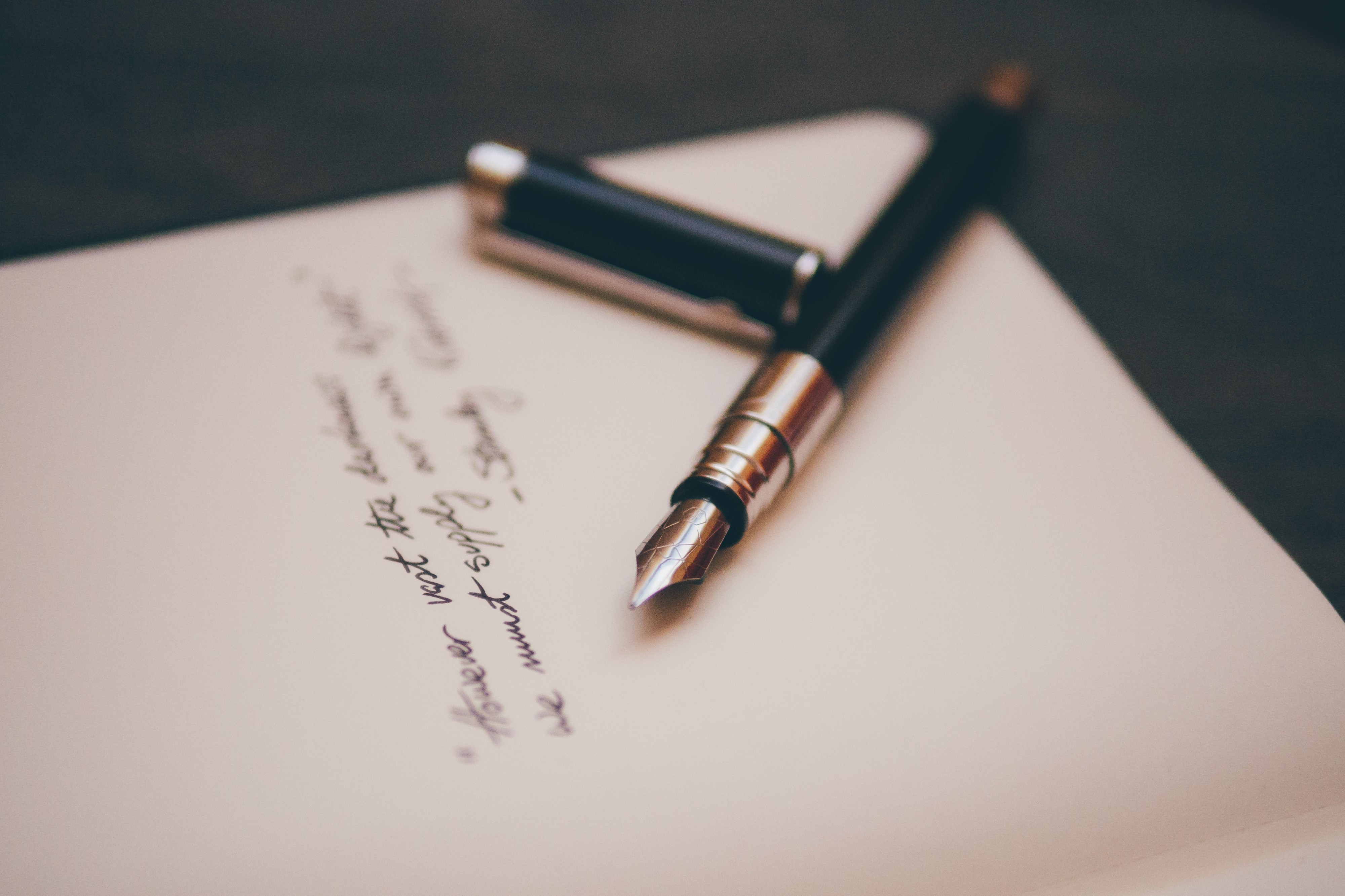 Writing the draft using pen and paper