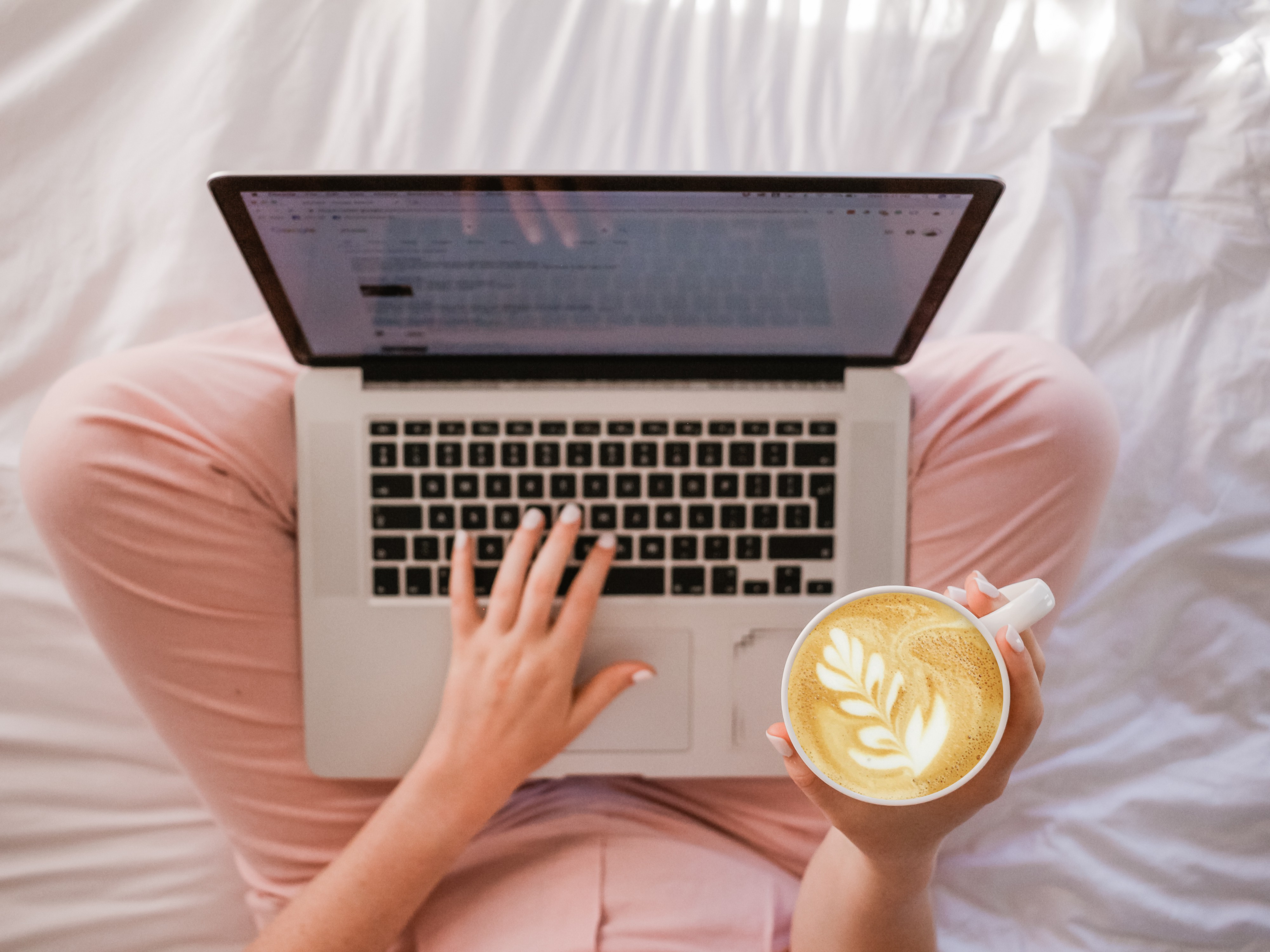 Web Hosting - Lady on a laptop drinking a cup of coffee.