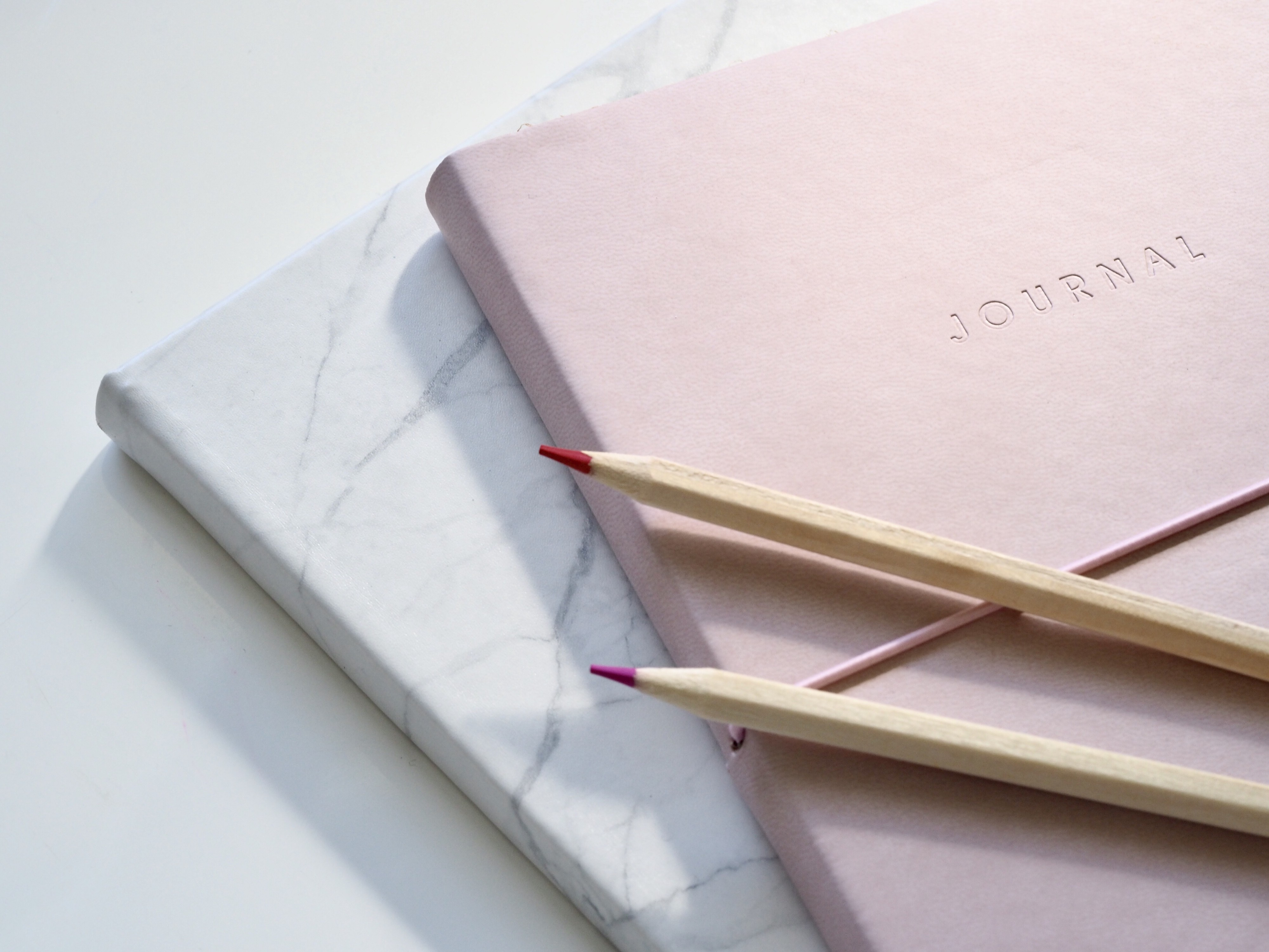 Journals and pencils on countertop
