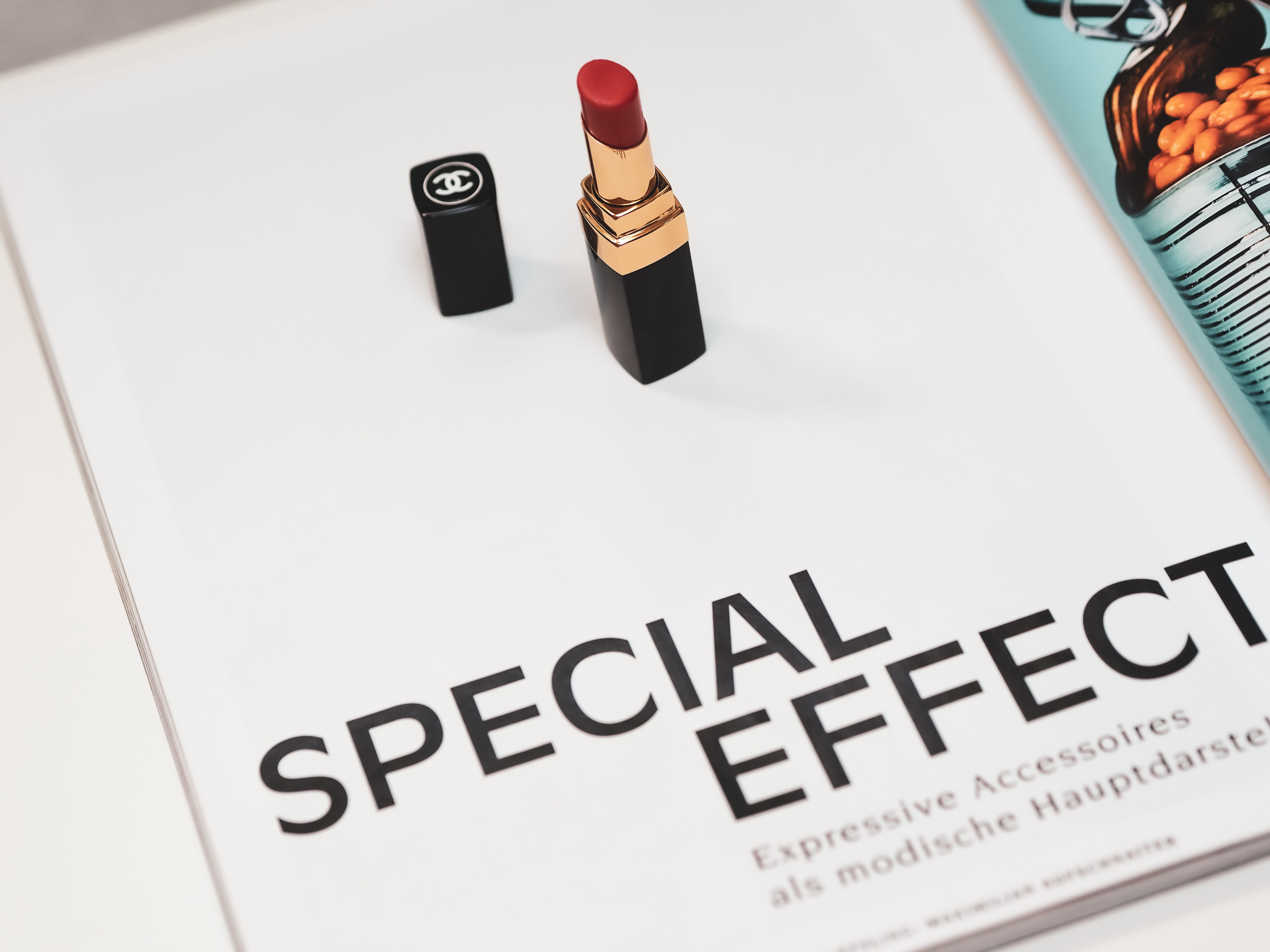 A book with SPECIAL EFFECT written on it. It has a red lipstick standing up on the page.