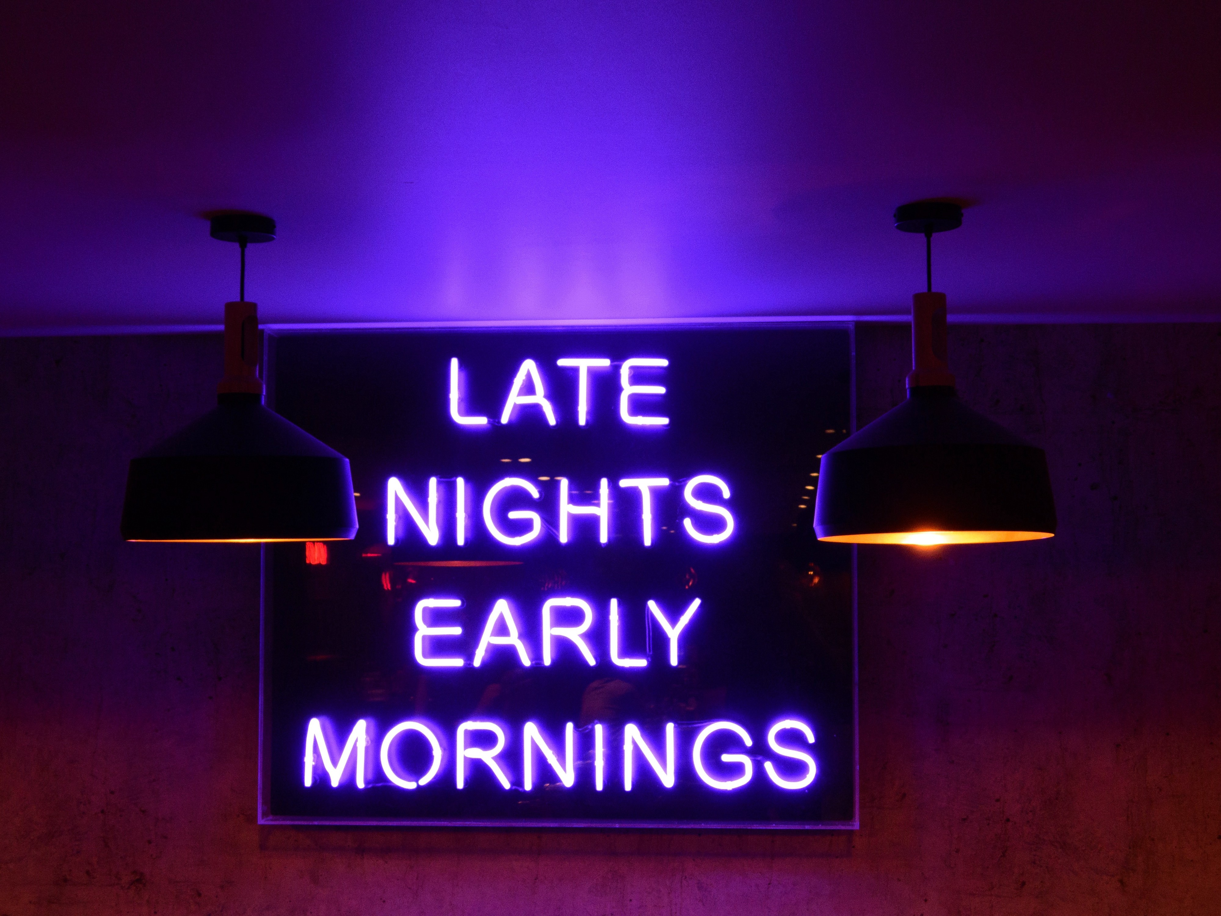 """Neon sign with the text """"Late Nights, Early Mornings"""""""