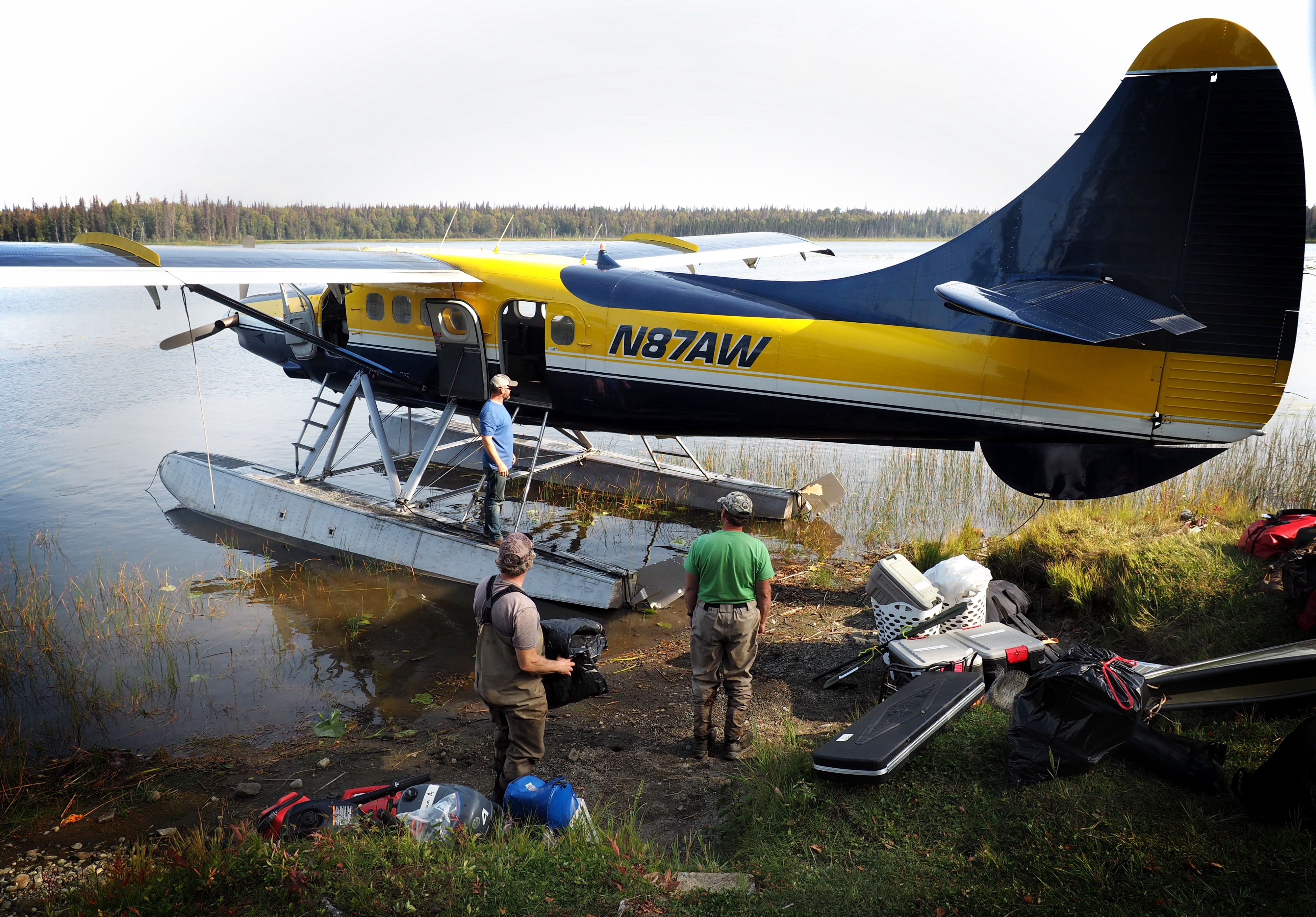 float plane with biologists and gear by a lake