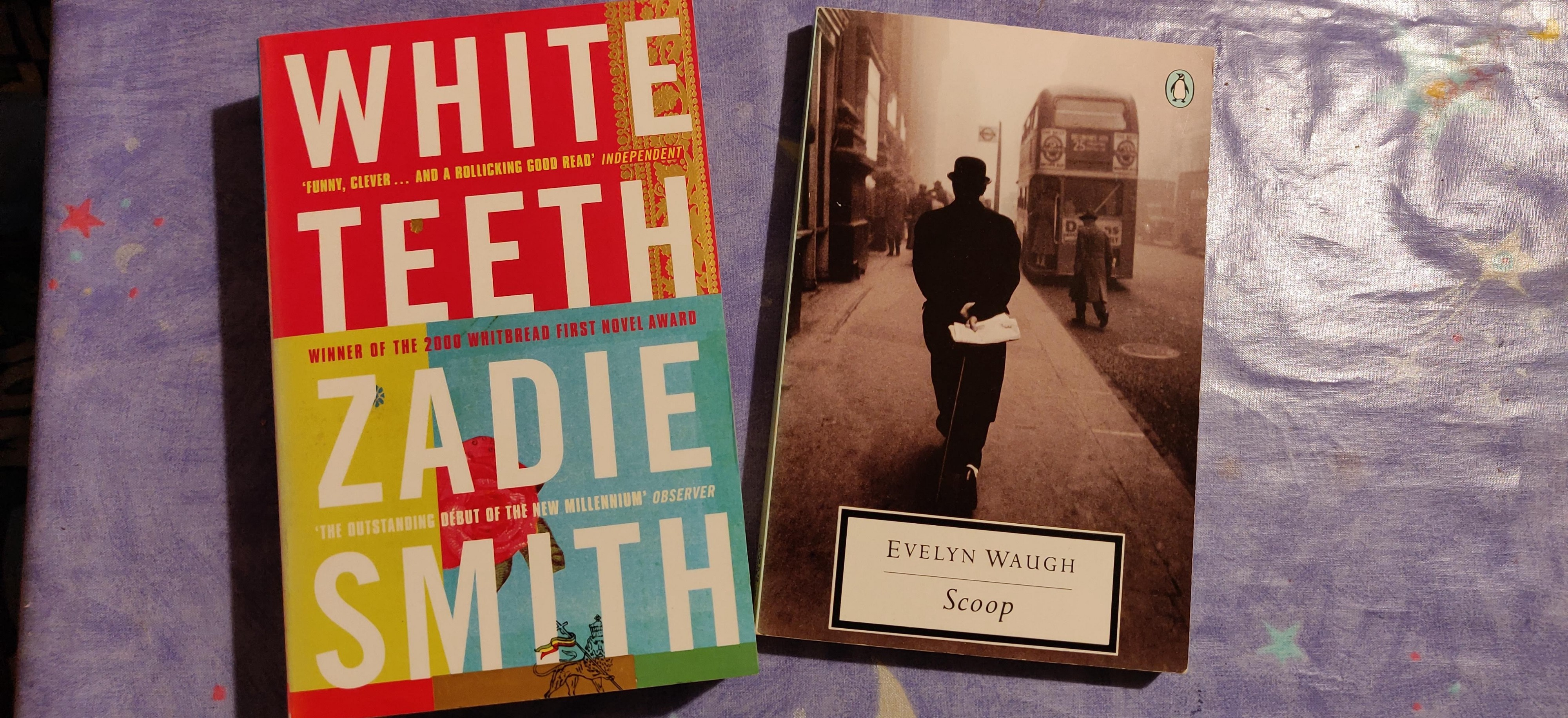 A photo of the books White Teeth and Scoop on my dining room table
