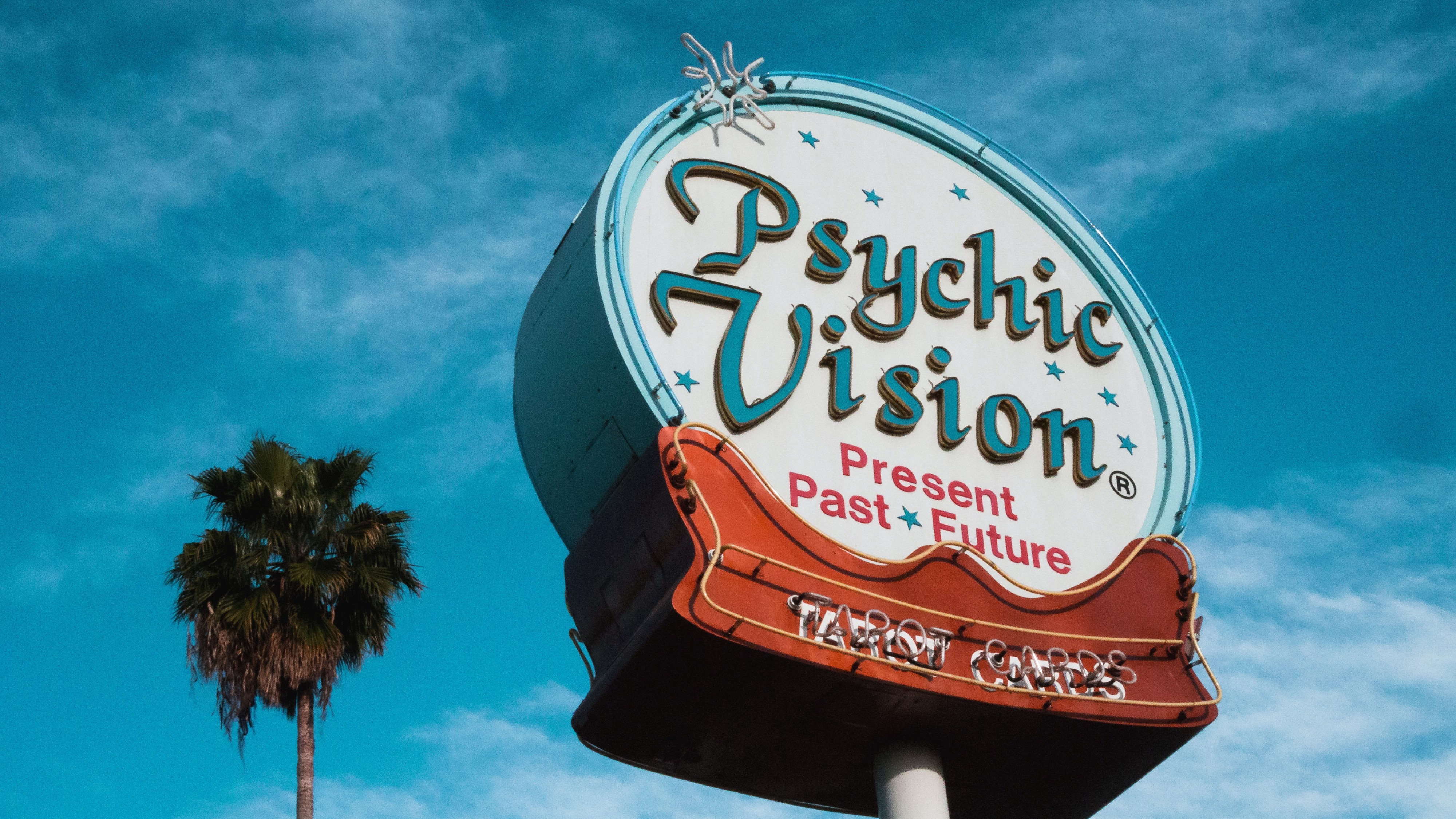 Photo by Wyron A on Unsplash, psychic sign gaudy high in the air