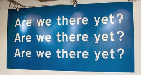 """A sign that asks """"Are we there yet?"""" three times."""