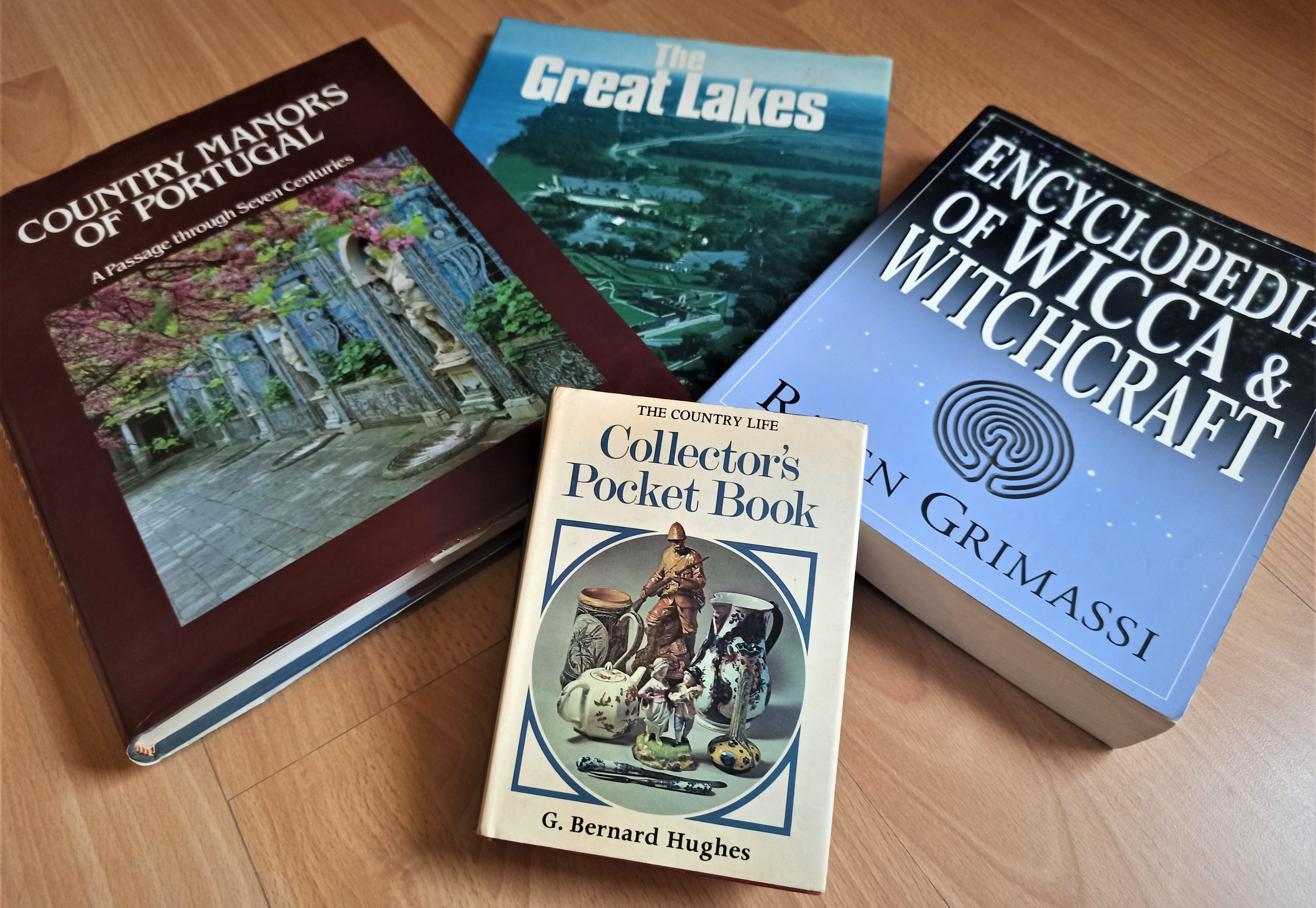 Various books, Country Manors of Portugal, Wicca and Witchcraft Encyclopedia, Collector's Pocket Book, Great Lakes.