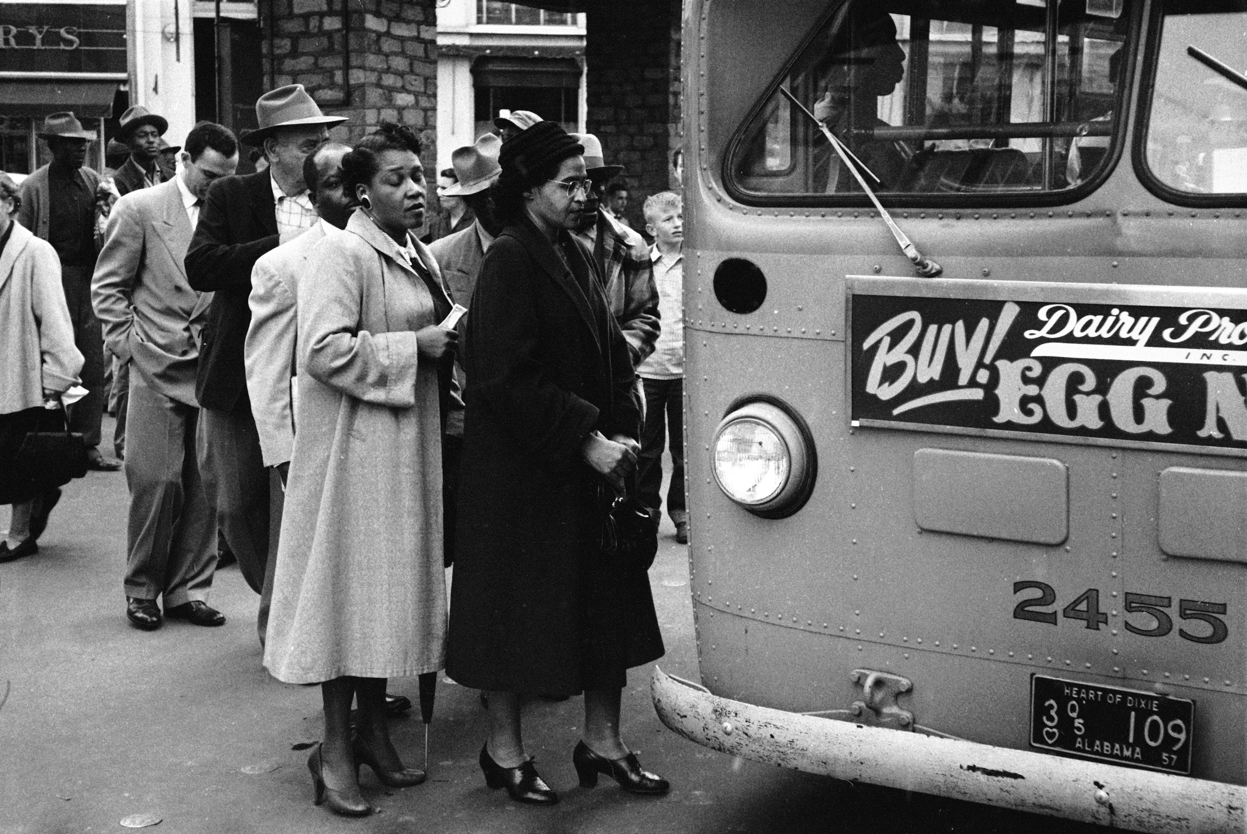 Rosa Parks waits to board a bus at the end of the Montgomery bus boycott