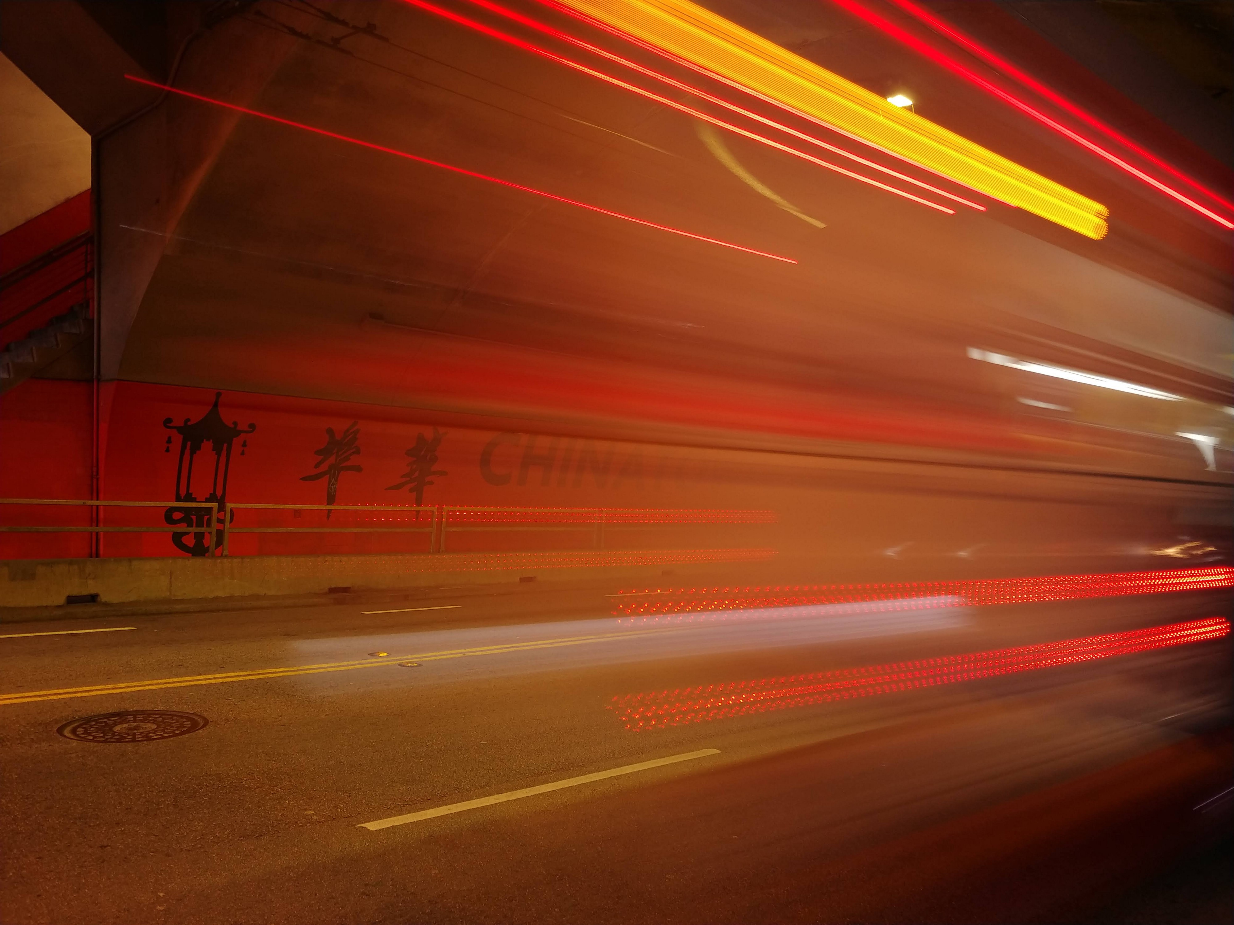 A long exposure shot of a moving vehicle inside a subway.
