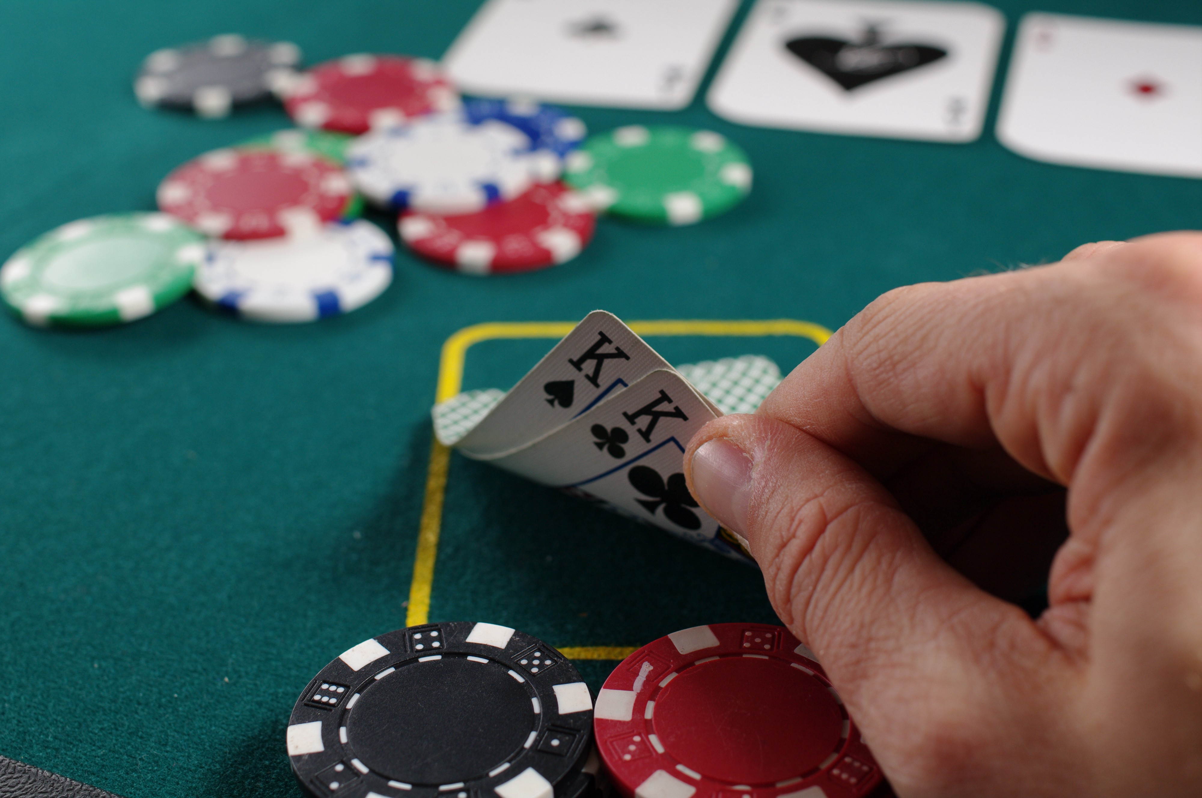 A poker player looking at the hand