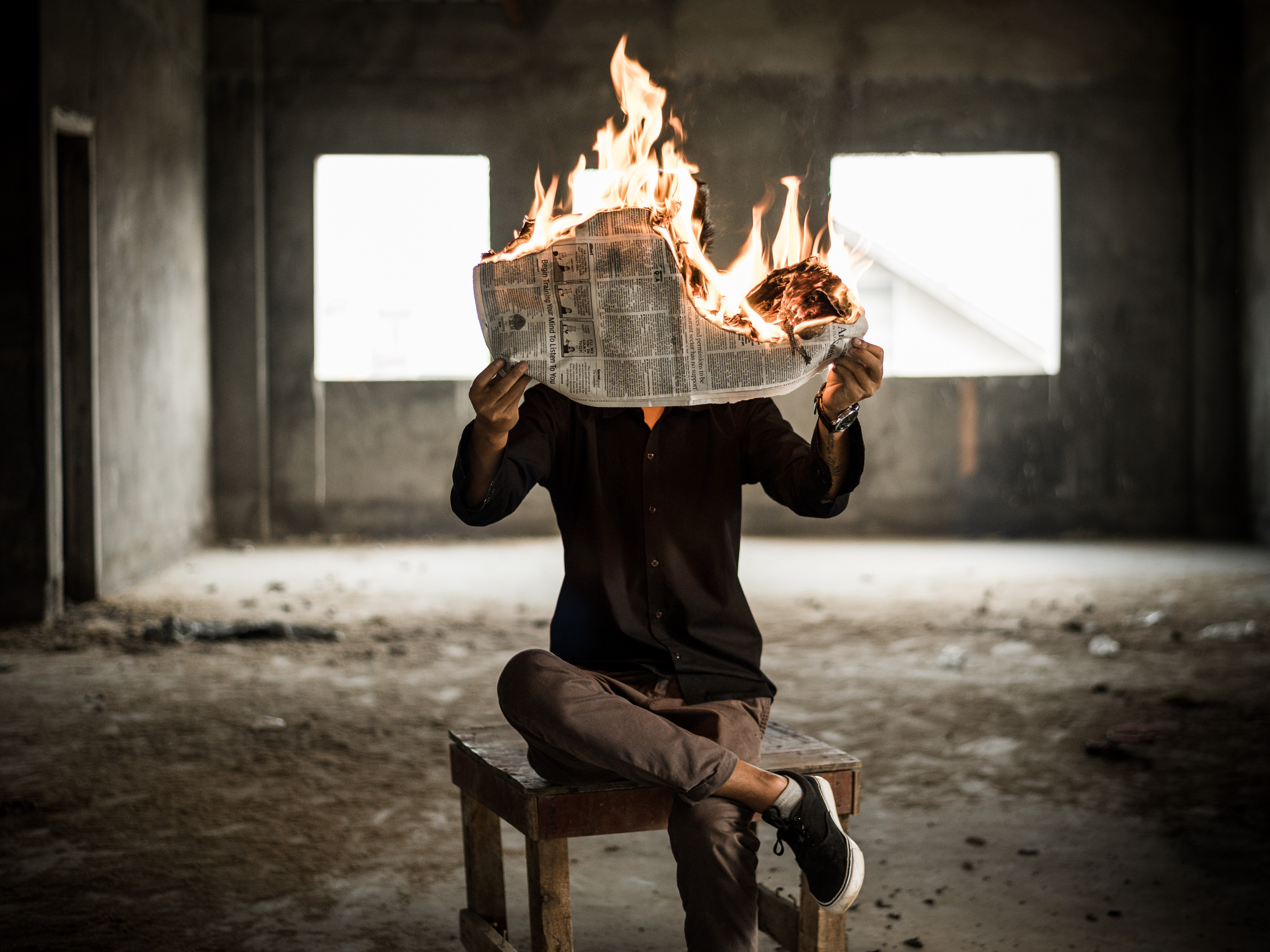 Person holding burning paper showing News Break deal went away
