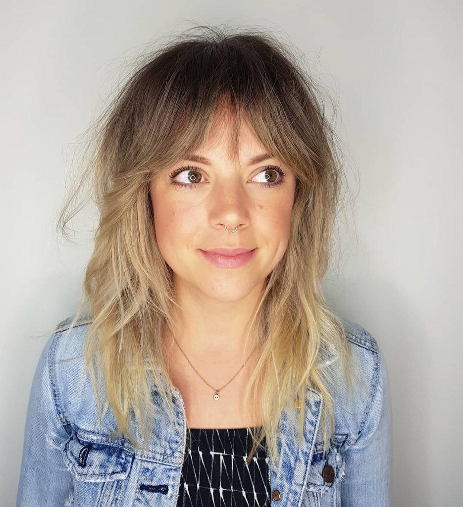 Blonde Sun Kissed Shag With Curtain Bangs And Undone Wavy Texture By Hairstyleology Medium