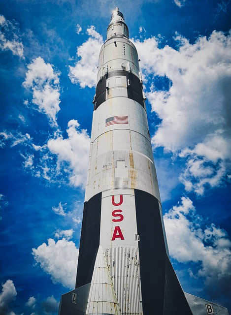 A Saturn V rocket seen from a low angle.