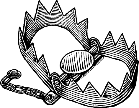 An open jagged-toothed metal jaw trap, lying in wait to be activated and clamp shut around its future prey.