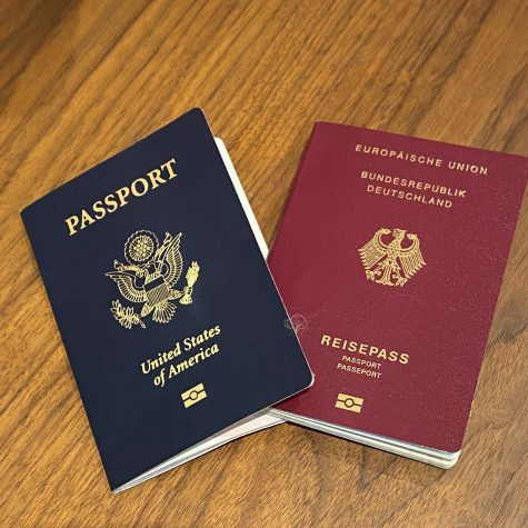 A german passport and an american passport on a wood background