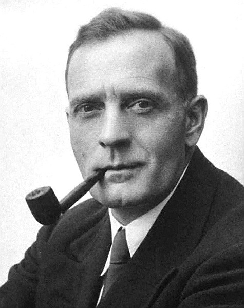 Edwin Hubble smoking a pipe.