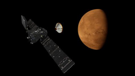 A lander separates from an orbiter above Mars.