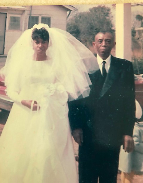 A vintage photo of Lillie Head with her father on her wedding day. She is wearing her wedding dress.