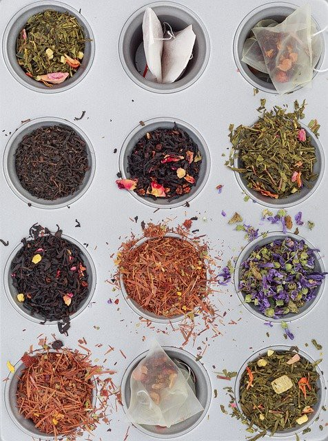 white background. 12 different cups with herbs. Abandon Your Herbal Fears: How to Create Tea Blends For Every Day by Nancy Blackman. tea. teas. herbs. herbal blends. ayurveda. traditional chinese medicine. tea blends. diy