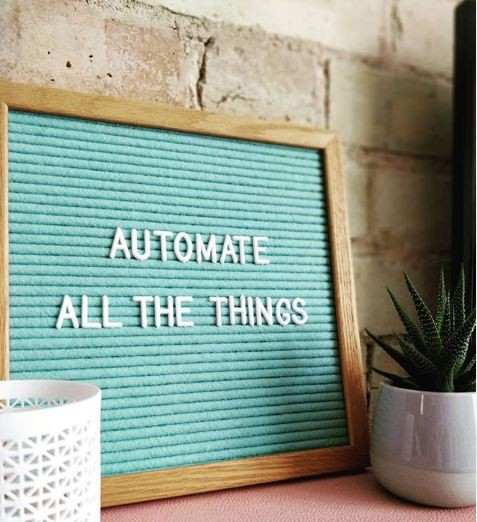 """Automate All the Things"" written on a board"