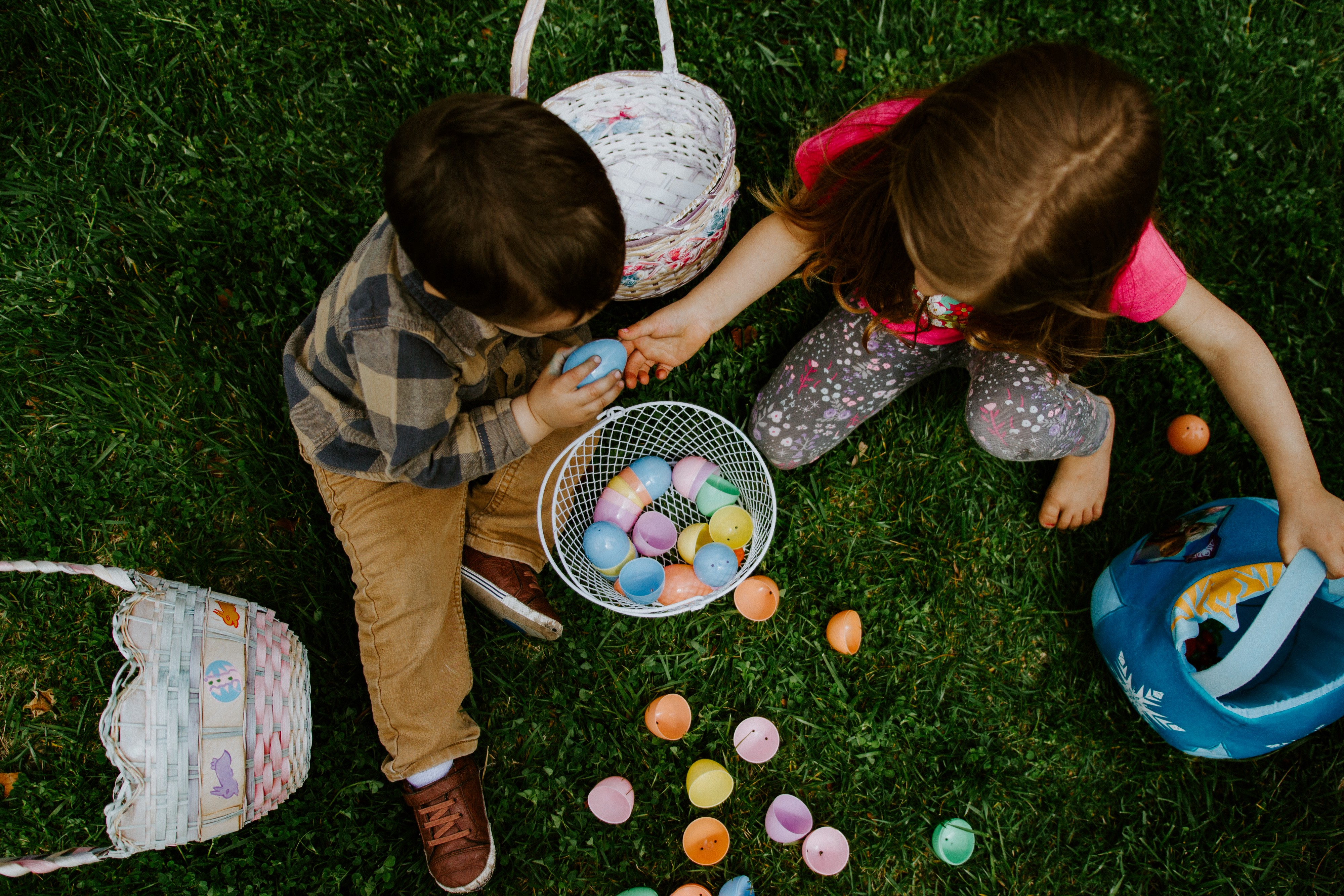 Kids with Easter baskets sharing Easter Eggs