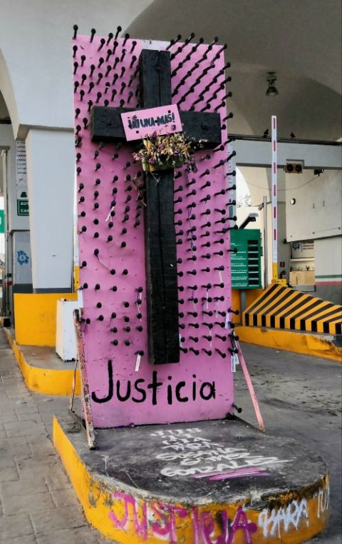 A pink cross with black naisl meant to draw attention to the problem of femicide in Ciudad Juárez, MX.