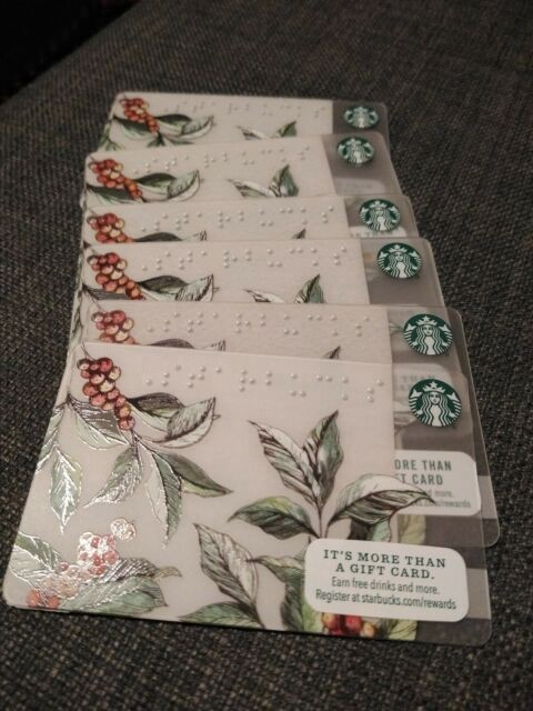Stack of six Starbucks gift cards with Braille letters spelling out STARBUCKS at the top. Decorated with coffee plants