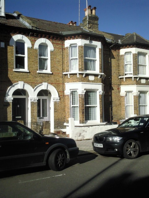 A photograph of a large Victorian terraced house.