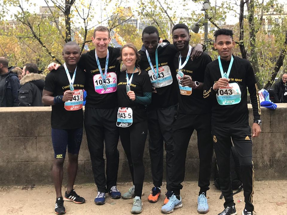 Noemie Marchyllie with her relay team at a Paris race
