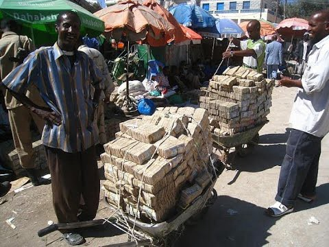 Inflation in Zimbabwe, currency becomes useless and piles.